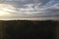 Nattlig utsikt från vårt fönster. Dimmorna dansar över Torne träsk och solen skiner.